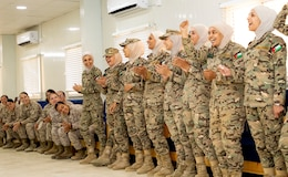 The 11th Marine Expeditionary Unit Female Engagement Team (FET) clap as members of the Jordan Armed Forces-Arab Army Quick Reaction Force FET sing their military song during subject matter expert exchange between the two countries August 7, 2019. The U.S. is committed to the security of Jordan and to partnering closely with JAF to meet common security challenges.