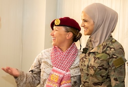 U.S. Marine Corps Capt. Katie Modzelewski (left), with 11th Marine Expeditionary Unit Female Engagement Team (FET), smiles after a member of the Jordan Armed Forces-Arab Army Quick Reaction Force (FET) positions one of their beret's on her to show their appreciation and unity following the closing ceremony for the subject matter exchange between the two countries August 7, 2019. The U.S. is committed to the security of Jordan and to partnering closely with JAF to meet common security challenges.