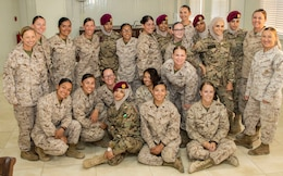Members of the 11th Marine Expeditionary Unit Female Engagement Team (FET) and the Jordan Armed Forces-Arab Army Quick Reaction Force FET pose together for a group photo following the closing ceremony for the subject matter exchange between the two countries August 7, 2019. The U.S. is committed to the security of Jordan and to partnering closely with JAF to meet common security challenges.