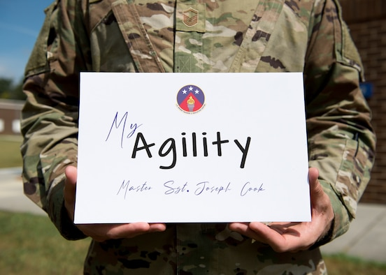 Airman holding sign