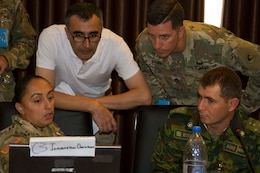From left, Army Staff Sgt. Myrna Bistros, intelligence support to information operations for exercise Regional Cooperation 2019, 303rd Information Operations Battalion, 151st Theater Informations Operations Group, United States Civil Affairs and Psychological Operations Command; Daler Djavadov, Tajikistan linguist for RC19; Army Sgt. 1st Class Jeremy Brown, operations sergeant major for RC19, 51st Troop Command, Massachusetts Army National Guard; and Tajik Army Capt. Nope Muhammad, information operations, Task Force Patriot; all discuss exercise operations during Regional Cooperation 2019 at Dushanbe, Tajikistan, August 10, 2019. Exercise Regional Cooperation is an annual exercise to help strengthen military-to-military relationships between the United States and partners in Central and South Asia. The exercise enhances regional security and stability among the participating nations.