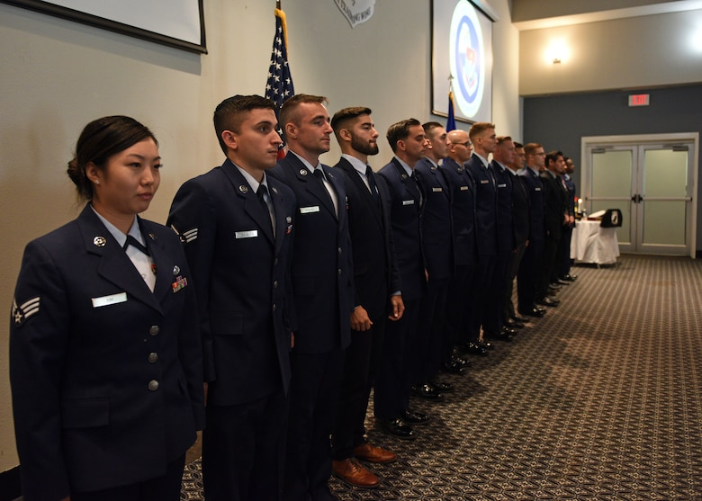 Airman Leadership School graduates form a line before being congratulated by leadership, instructors, and guests during the ALS graduation at the event center on Goodfellow Air Force Base, Texas, August 22, 2019. The uniformed members and civilian employees completed the four-week course to learn leadership skills. (U.S. Air Force photo by Airman 1st Class Robyn Hunsinger/Released)