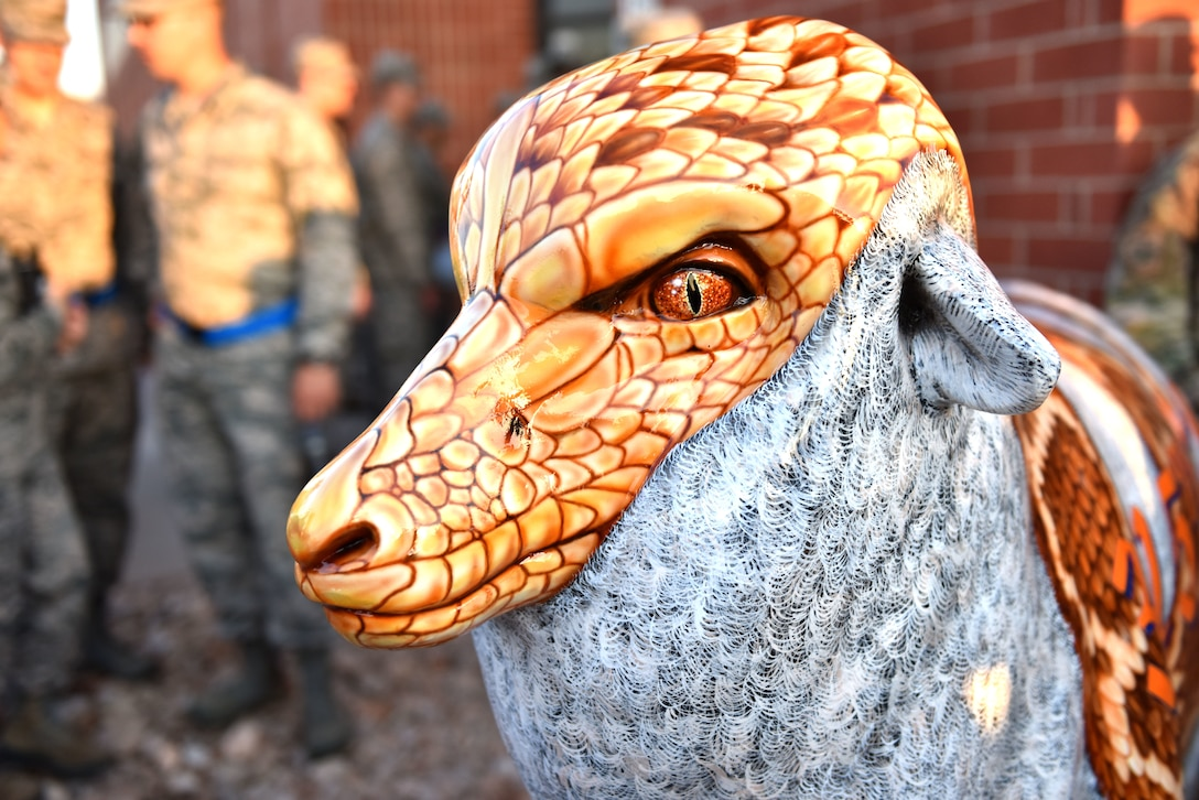 Ricky the Rattler, a fiberglass sheep painted in homage to the 315th Training Squadron's mascot is on display outside of Di Tommaso Hall on Goodfellow Air Force Base, Texas. The 315th TRS is one of five training squadrons underneath the leadership of the 17th Training Wing. (U.S. Air Force photo by Senior Airman Seraiah Wolf/Released)