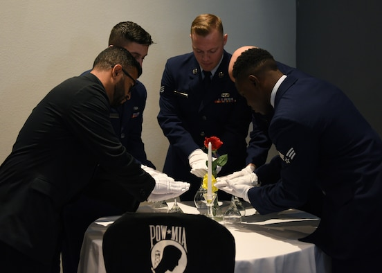 Graduates of Airman Leadership School set the POW/MIA table prior to the ALS Graduation ceremony at the event center on Goodfellow Air Force Base, Texas, August 22, 2019. The table was set as a symbol of honor and remembrance of America's prisoners of war and missing comrades across all branches. (U.S. Air Force photo by Airman 1st Class Robyn Hunsinger/Released)