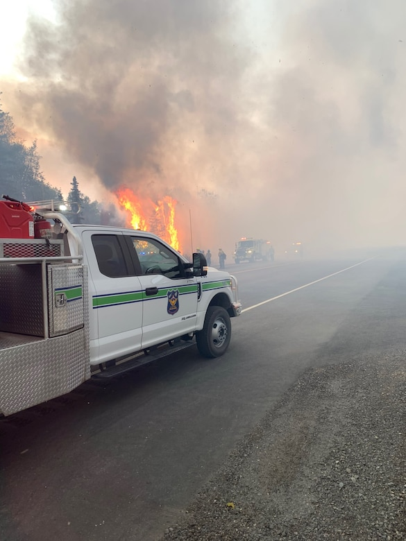 Joint Base Elmendorf-Richardson firefighters engage in fire suppression efforts on the McKinley Fire near mile marker 90.5 along the Parks Highway in Alaska, Aug. 18, 2019. The Matanuska-Susitna area fire management officer requested assistance from the JBER taskforce, which immediately responded and fought the fire alongside local and state firefighters.