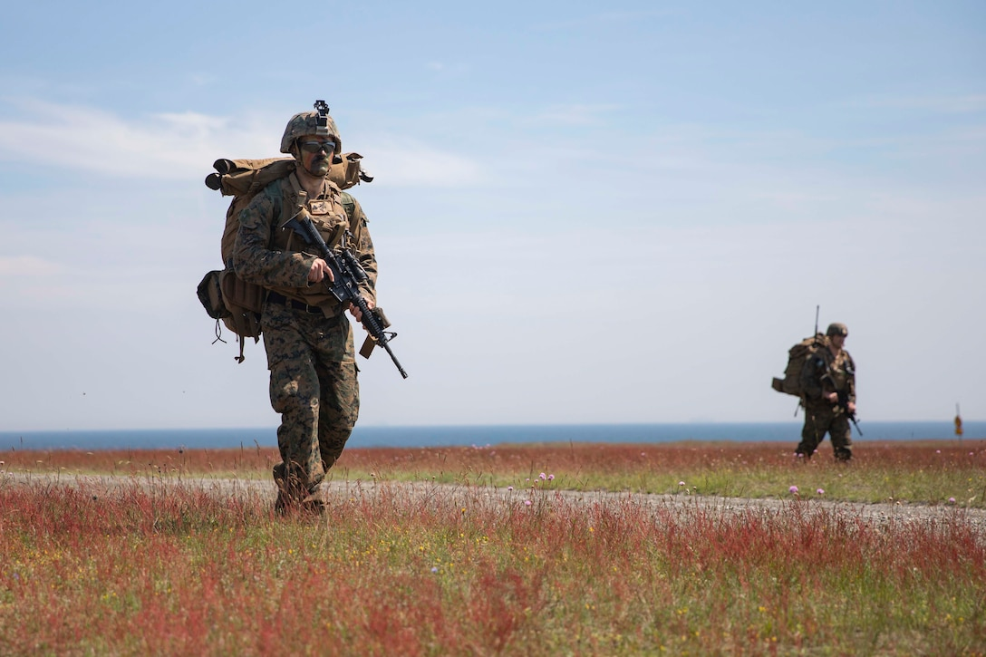 U.S. Marine Cpl. William Chapman, a machine gunner with the 22nd Marine Expeditionary Unit, carries his pack during a patrol in Sweden for Baltic Operations (BALTOPS), June 19, 2019. The Marines practiced a company sized attack on an objective as part of training for BALTOPS 2019. BALTOPS is an annual joint, multinational maritime-focused exercise. It is designed to improve training for participants, enhance flexibility and interoperability, and demonstrate resolve among allied and partner forces in defending the Baltic Sea region. (U.S. Marine photo by Lance Cpl. Antonio Garcia/Released)