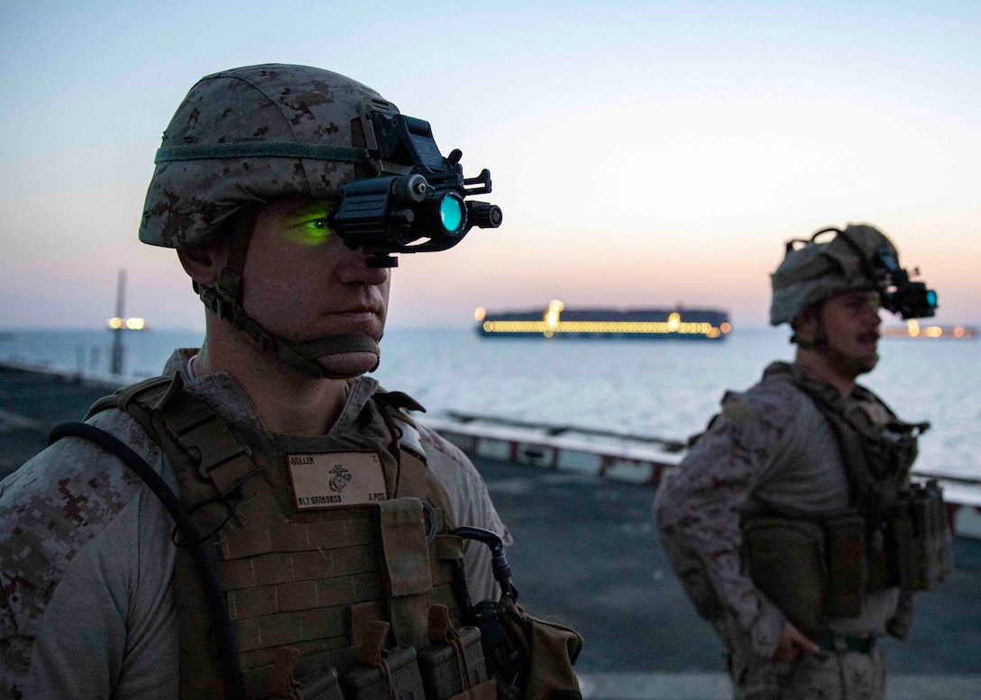 190620-M-QT322-1008 SUEZ CANAL (June 20, 2019) U.S. Sailor Petty Officer 3rd Class Thomas Miller, a hospitla corpsman with the 22nd Marine Expeditionary Unit, tests night vision goggles on the flight deck of the San Antonio-class amphibious transport dock ship USS Arlington (LPD 24) before transiting the Suez Canal, June 20. The 22nd MEU and the Kearsarge Amphibious Ready Group are deployed to the U.S. 5th Fleet area of operations in support of naval operations to ensure maritime stability and security in the central region, connecting the Mediterranean and the Pacific through the western Indian Ocean and three strategic choke points. (U.S. Marine Corps photo by Staff Sgt. Andrew Ochoa/Released)