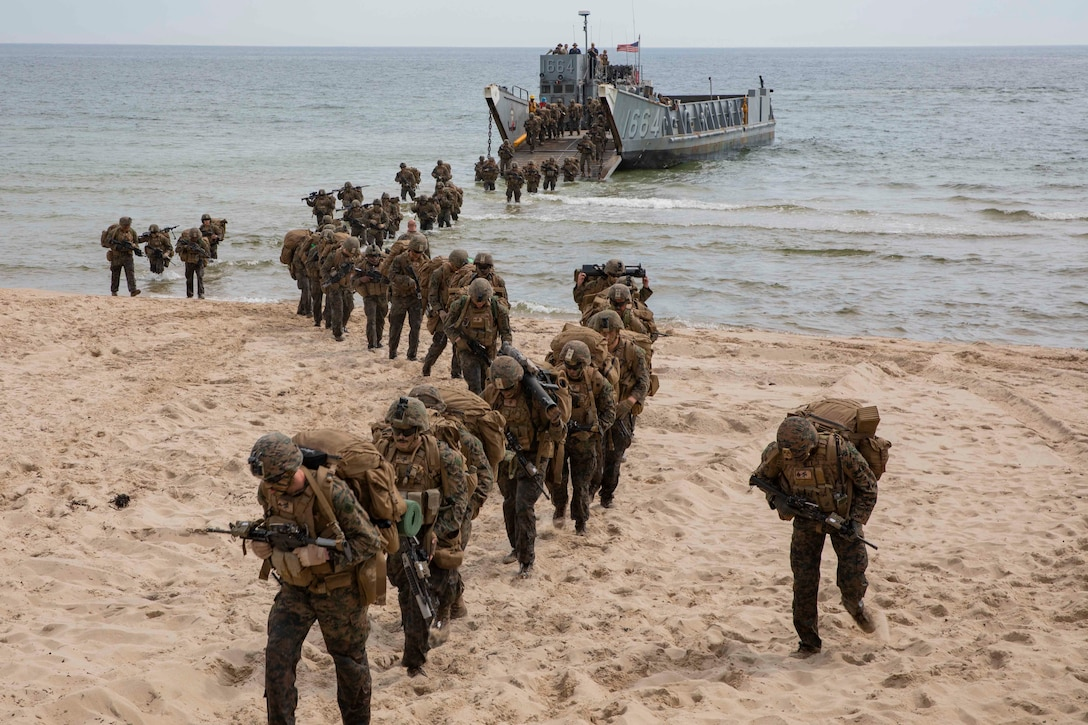 U.S. Marines disembark a Landing Craft, Utility during an infantry training event in Sweden for Baltic Operations (BALTOPS), June 19, 2019. The Marines practiced a company sized attack on an objective as part of training for BALTOPS2019. BALTOPS is an annual joint, multinational maritime-focused exercise. It is designed to improve training for participants, enhance flexibility and interoperability, and demonstrate resolve among allied and partner forces in defending the Baltic Sea region. (U.S. Marine photo by Lance Cpl. Antonio Garcia/Released)
