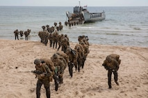 U.S. Marines disembark a Landing Craft, Utility during an infantry training event in Sweden for Baltic Operations (BALTOPS), June 19, 2019.