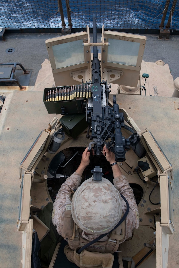 U.S. Marine Lance Cpl. Michael Anderson Jr., a machine gunner with the 22nd Marine Expeditionary (MEU), stands watch in the turret of a Humvee on the flight deck of the Whidbey Island-class amphibious dock landing ship USS Fort McHenry (LSD-43) during the transit through the Bab-El-Mandeb strait. Marines and Sailors stood watch throughout the ship to protect the ship as it transited through the strait. Marines and Sailors with the 22nd MEU and Kearsarge Amphibious Ready Group are currently deployed to the U.S. 5th Fleet area of operations in support of naval operations to ensure maritime stability and security in the Central Region, connecting the Mediterranean and the Pacific through the western Indian Ocean and three strategic choke points. (U.S. Marine Corps photo by Lance Cpl. Antonio Garcia/Released)