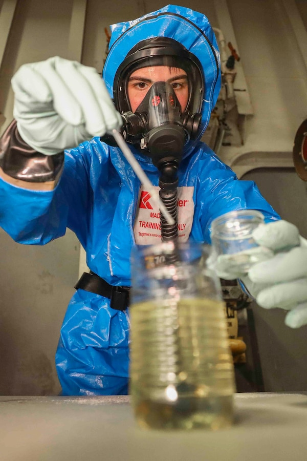 190510-M-YD783-2200 ARABIAN SEA (MAY 10, 2019) U.S. Marine Cpl. Haley Brunette, a chemical, biological, radiological and nuclear defense specialist with the 22nd Marine Expeditionary Unit, extracts a liquid sample from a notional anonymous container during scenario based reconnaissance and sampling training in the well deck of the Wasp-class amphibious assault ship USS Kearsarge (LHD-3). The CBRN Marines conducted the training to maintain combat readiness standards and sharpen their skills. Marines and Sailors with the 22nd MEU and Kearsarge Amphibious Ready Group are deployed to the 5th Fleet area of operations in support of naval operations to ensure maritime stability and security in the Central Region, connecting the Mediterranean and the Pacific through the western Indian Ocean and three strategic choke points. (U.S. Marine Corps photo by Cpl. Tawanya Norwood/Released)