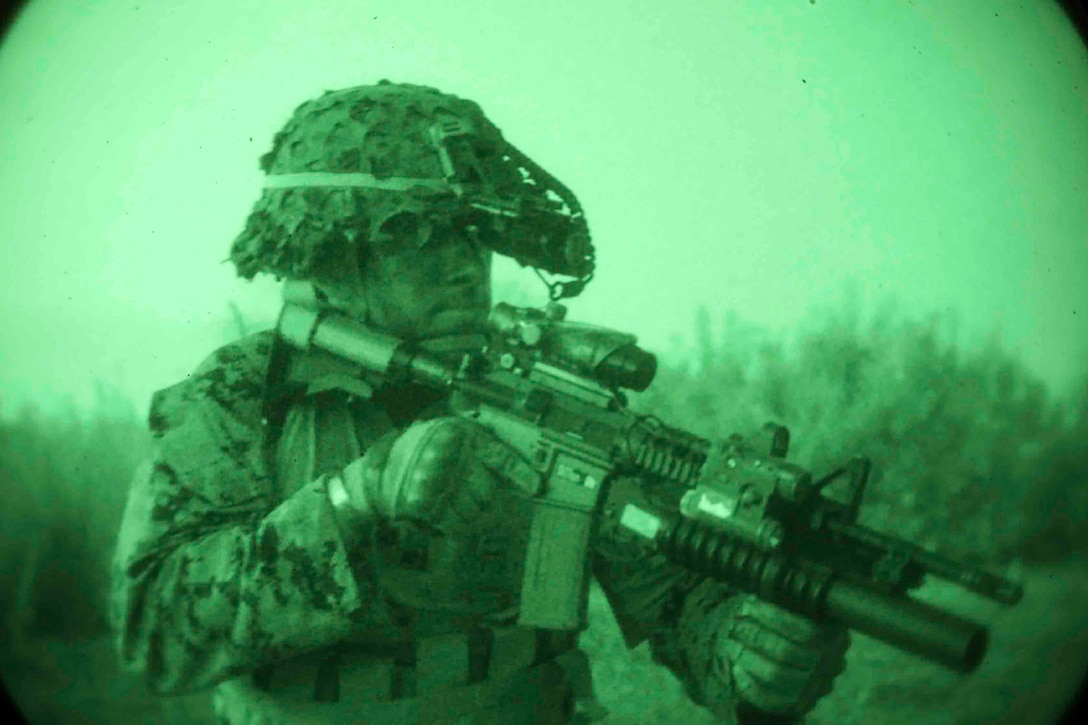 190502-M-QT322-0008 ROTA, SPAIN (May 2, 2019) U.S. Marine Lance Cpl. Robert McArter, a rifle Marine with the 22nd Marine Expeditionary Unit, patrols at night during patrol base operation training during Sustainment Exercise 2019 aboard Naval Air Station Rota, Spain, May 2, 2019. The 22nd MEU and the Kearsarge Amphibious Ready Group are making a scheduled deployment in support of maritime security operations, crisis response and theatre security cooperation, while also providing a forward Naval and Marine presence. (U.S. Marine Corps photo by Staff Sgt. Andrew Ochoa)