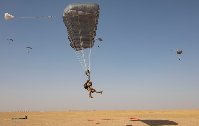 U.S. Marine Gunnery Sgt. Patrick Keeling, left, the Maritime Raid Force operations chief, prepares to land with 1st Lt. Austin Ahmed, the platoon commander for the Maritime Raid Force's 3rd Platoon, both with the 22nd Marine Expeditionary Unit, as part of a tandem freefall jump during Marine Expeditionary Unit Exercise, April 19, 2019.