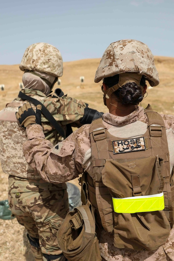 190424-M-YD783-1349 JOINT TRAINING CENTER, Jordan (April 24, 2019) U.S Marine Cpl. Koral Hose, a radio operator with the 22nd Marine Expeditionary Unit's female engagement team, assist as a positon safety officer during a live fire combat marksmanship range. During the range, Marines and Sailors exchanged combat tactics, techniques and procedures with foreign troops. Marines and Sailors with the 22nd MEU and Kearsarge Amphibious Ready Group are deployed to the 5th Fleet area of operations in support of naval operations to ensure maritime stability and security in the Central Region, connecting the Mediterranean and the Pacific through the western Indian Ocean and three strategic choke points. (U.S. Marine Corps photo by Cpl. Tawanya Norwood/Released)