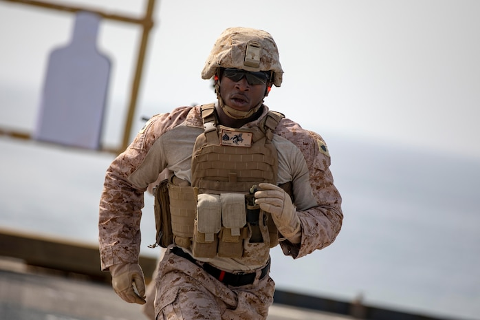 U.S. Marine Sgt. Nathaniel Dunchie, an infantry squad leader with the 22nd Marine Expeditionary Unit, sprints during a stress shoot on the flight deck of the Whidbey Island-class dock landing ship USS Fort McHenry (LSD-43) April 3, 2019.