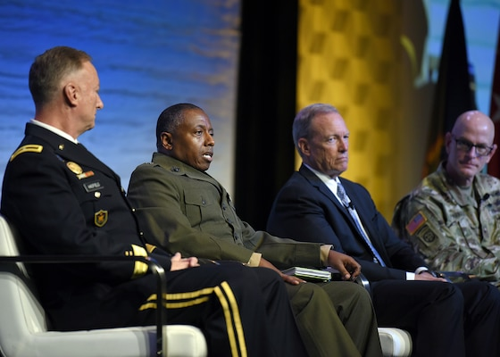 U.S. Marine Corps Brig. Gen. Dimitri Henry, U.S. Central Command director of intelligence, second from left, discusses breaking down organizational stovepipes during the Defense Intelligence Agency DoDIIS Worldwide Conference Directors of Intelligence panel, Aug. 21, 2019, at the Tampa Convention Center, in Florida.