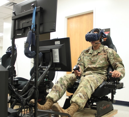 "U.S. Air Force 2nd Lt. Isaac Perez flies a training sortie on a virtual reality simulator at Air Education and Training Command's Det. 24 at Joint Base San Antonio-Randolph Aug. 20. Perez, who is awaiting the start of version three of ""Pilot Training Next,"" was the 2019 winner of the Intercollegiate Tennis Association's national Arthur Ashe Jr. Leadership and Sportsmanship award."