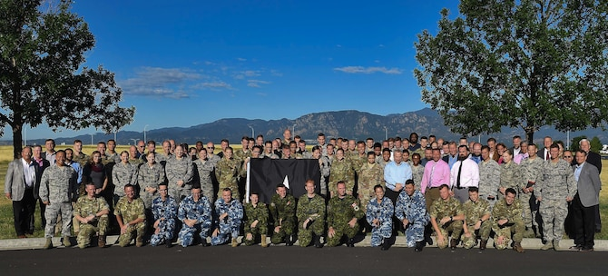 "Coalition partners from Australia, Canada, Great Britain and the United States join Space Flag's first coalition exercise, Colorado Springs, Colorado, Aug. 12-16, 2019. Space Flag 19-3 integrated its Allied partners in Air Force Space Command's ""Fight Tonight"" exercise focused on using current capabilities to deter, deny and disrupt adversarial actions in the space domain. (Courtesy photo)"