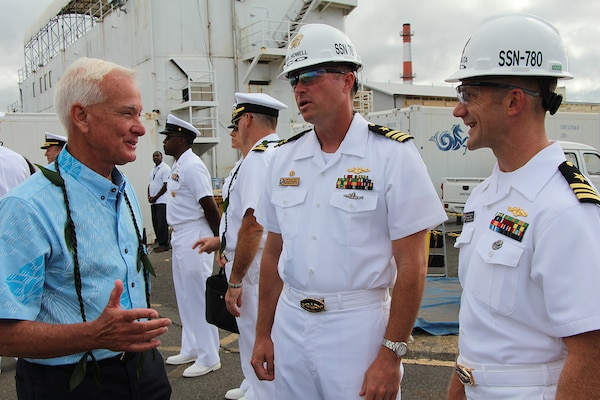 Mayor Kirk Caldwell (left) gets acquianted with CDR George Howell, USS MISSOURI (SSN-780) Commanding Officer, and LCDR Jeremy Nauta, USS MISSOURI (SSN-780) Executive Officer, at the Pearl Harbor Naval Shipyard's centennial anniversary of Dry Dock One on Aug. 21, 2019, at Dry Dock One.