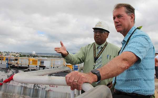 John Ornellas, PHNSY&IMF Director of Radiological Controls (left) explains the significance of Dry Dock One to Rep. Ed Case (right) during the Pearl Harbor Naval Shipyard's centennial anniversary of Dry Dock One on Aug. 21, 2019, at Dry Dock One.