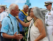 Mayor Kirk Caldwell (left) is greeted by Aunty Kehaulani Lum, an Ali'i Pauahi Hawaii Civic Club member, at the Pearl Harbor Naval Shipyard's centennial anniversary of Dry Dock One on Aug. 21, 2019, at Dry Dock One.