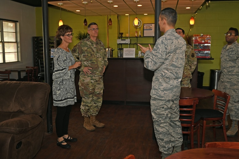 U.S. Air Force Capt. Bermsoo Kim, 7th Bomb Wing chaplain, explains the current ministry of the Soul Fire Cafe to Gen. Tim Ray, Commander of Air Force Global Strike Command, and his wife, Rhonda, at Dyess Air Force Base, Texas, Aug. 22, 2019. The Soul Fire Cafe was started by Ray, his wife and the chaplains while he was in command of the 7th BW in 2008, and was an effort to reach out and build connections between Airmen. (U.S. Air Force photo by Senior Airman Susan Roberts)