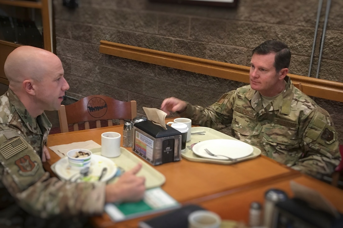 U.S. Air Force Lt. Col. Rob Marshall, left, deputy chief of the Research and Scholarship Division at the Center for Character and Leadership Development at the U.S. Air Force Academy, meets with U.S. Air Force Brig. Gen. Claude Tudor, director of Air Force Resilience, Aug. 20, 2019, at Joint Base Elmendorf-Richardson, Alaska. They discussed ways that adventure- and experiential-based learning could potentially be included in broader Air Force resiliency efforts.