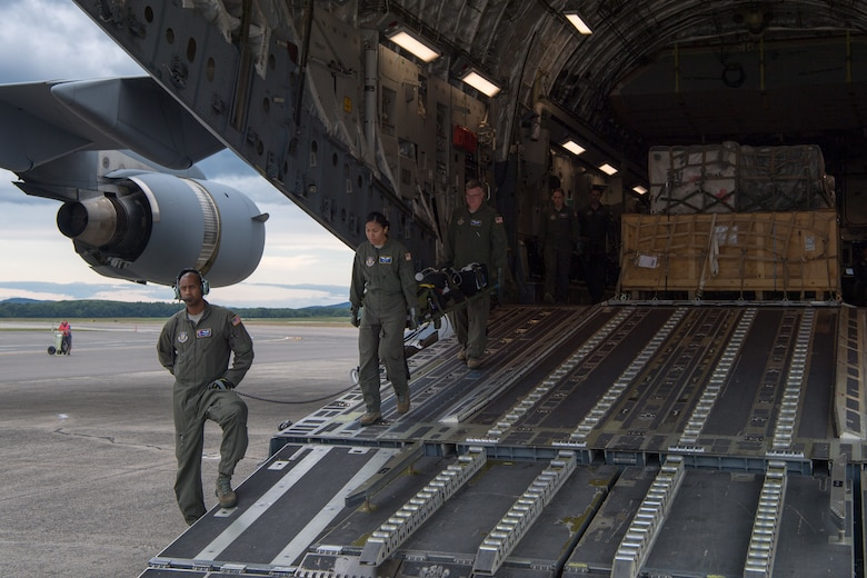 Reserve Citizen Airmen from the 514th Aeromedical Evacuation Squadron, 514th Air Mobility Wing, Joint Base McGuire-Dix-Lakehurst, N.J., assist the 914th AES, Niagara Falls Air Reserve Station, N.Y., in unloading cargo and equipment from a C-17 Globemaster III following the completion of Patriot Warrior 2019, August 24, 2019. Members of the 732nd Airlift Squadron and 514th AES cooperated with various squadrons across the U.S. Air Force Reserve including the 934th Logistics Readiness Squadron, the 439th AES, and the 914th AES, as well as the United Kingdom's Royal Air Force. Patriot Warrior is the Air Force Reserve Command's premier exercise, providing an opportunity for Reserve Citizen Airmen to train with joint and international partners in airlift, aeromedical evacuation and mobility support.