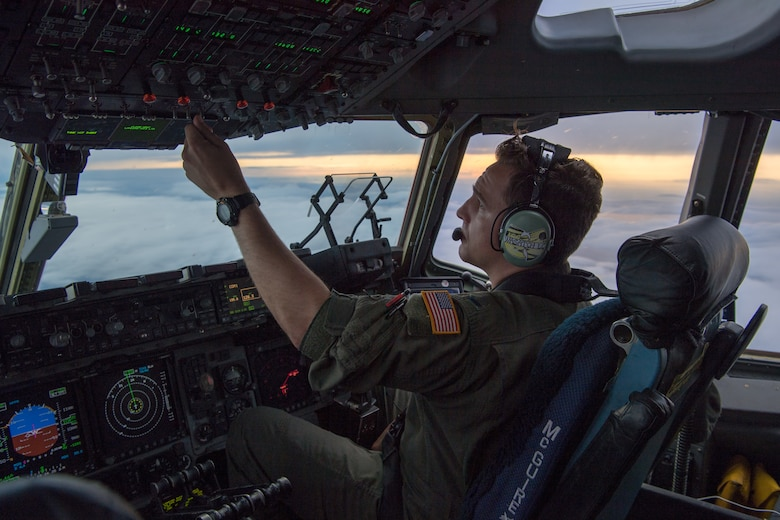 1st Lt. Nolan S. Lynn, 732nd Airlift Squadron pilot with the 514th Air Mobility Wing, Joint Base McGuire-Dix-Lakehurst, N.J., flies a C-17 Globemaster III with members from the 732nd AS and 514th Aeromedical Evacuation Squadron back to JBMDL after returning participants in Patriot Warrior 2019 to their home bases, August 24, 2019. Members of the 732nd AS and 514th AES cooperated with various squadrons across the U.S. Air Force Reserve including the 934th Logistics Readiness Squadron, the 439th AES, and the 914th AES, as well as the United Kingdom's Royal Air Force. Patriot Warrior is the Air Force Reserve Command's premier exercise, providing an opportunity for Reserve Citizen Airmen to train with joint and international partners in airlift, aeromedical evacuation and mobility support.