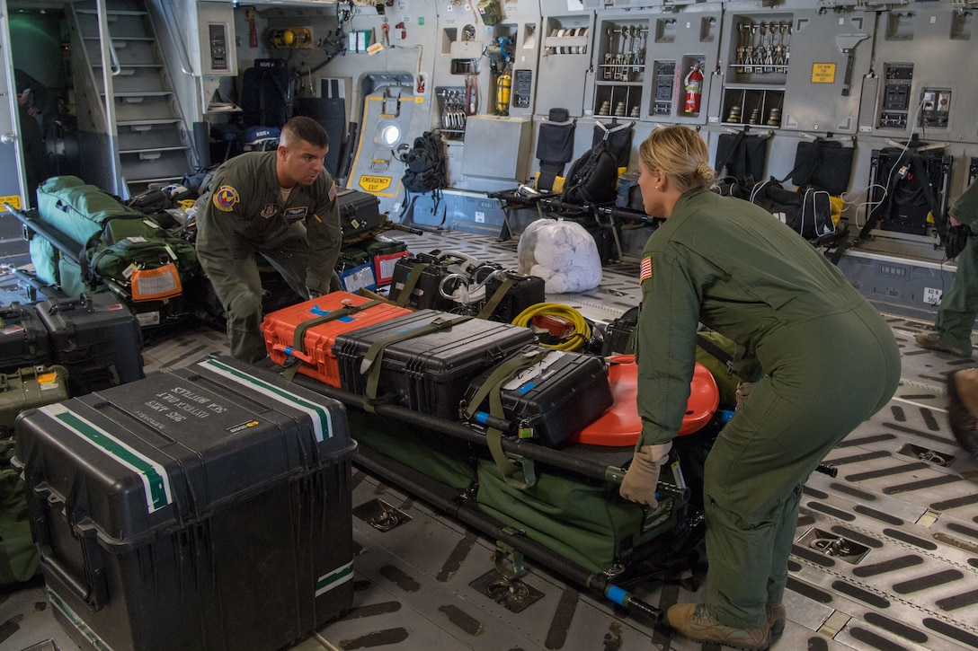 Tech. Sgt. Darwin Najera, and Staff Sgt. Suzanne Milligan both medical technicians with the 439th Aeromedical Evacuation Squadron, Westover Air Reserve Base, Mass., load cargo and equipment on a C-17 Globemaster III following the completion of Patriot Warrior 2019 in Minneapolis-St Paul Air Reserve Station, Minn., August 24, 2019. Members of the 732nd Airlift Squadron and 514th AES cooperated with various squadrons across the U.S. Air Force Reserve including the 934th Logistics Readiness Squadron, the 439th AES, and the 914th AES, as well as the United Kingdom's Royal Air Force. Patriot Warrior is the Air Force Reserve Command's premier exercise, providing an opportunity for Reserve Citizen Airmen to train with joint and international partners in airlift, aeromedical evacuation and mobility support.