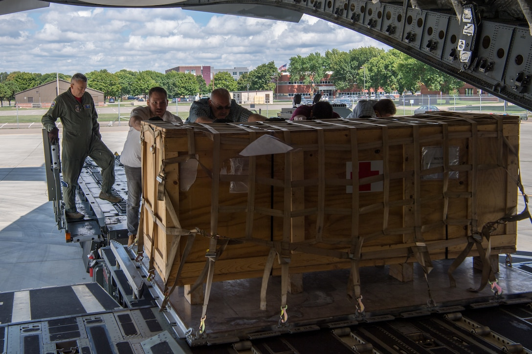 Chief Master Sgt. Juan Claudio, 732nd Airlift Squadron, loadmaster with the 514th Air Mobility Wing, Joint Base McGuire-Dix-Lakehurst, N.J., and members from the 934th Logistics Readiness Squadron, Minneapolis-St Paul Air Reserve Station, Minn., load a pallet of supplies onto a C-17 Globemaster III following the completion of Patriot Warrior 2019 in Minneapolis-St Paul Air Reserve Station, Minn., August 24, 2019. Members of the 732nd AS and 514th Aeromedical Evacuation Squadron cooperated with various squadrons across the U.S. Air Force Reserve including the 934th LRS, the 439th AES, and the 914th AES, as well as the United Kingdom's Royal Air Force. Patriot Warrior is the Air Force Reserve Command's premier exercise, providing an opportunity for Reserve Citizen Airmen to train with joint and international partners in airlift, aeromedical evacuation and mobility support.