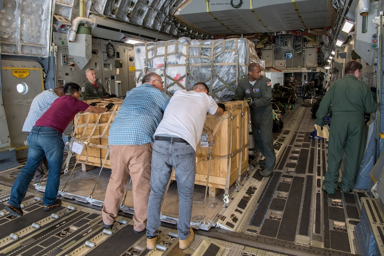 Reserve Citizen Airmen from the 732nd Airlift Squadron, 514th Air Mobility Wing, Joint Base McGuire-Dix-Lakehurst, N.J., and 934th Logistics Readiness Squadron, Minneapolis-St Paul Air Reserve Station, Minn., ensure a pallet of supplies are locked in place on a C-17 Globemaster III following the completion of Patriot Warrior 2019 in Minneapolis-St Paul Air Reserve Station, August 24, 2019. Members of the 732nd AS and 514th Aeromedical Evacuation Squadron cooperated with various squadrons across the U.S. Air Force Reserve including the 934th LRS, the 439th AES, and the 914th AES, as well as the United Kingdom's Royal Air Force. Patriot Warrior is the Air Force Reserve Command's premier exercise, providing an opportunity for Reserve Citizen Airmen to train with joint and international partners in airlift, aeromedical evacuation and mobility support.