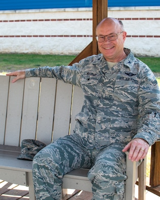 Col. Keith Williams, 136th Airlift Wing Vice Commander, takes a quick break on a bench outside the headquarters building.