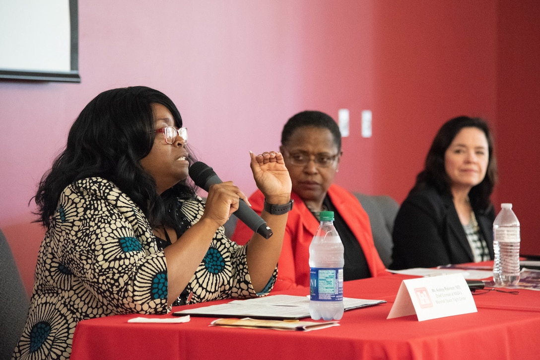 Audrey Robinson, Esq., left, chief of counsel at NASA Marshall Space Flight Center, speaks during a Women's Equality Day discussion panel at the U.S. Army Engineering and Support Center, Huntsville, Alabama, Aug. 22, 2019. Next to Robinson is Dr. Juanita M. Christensen, executive director of the U.S. Army Combat Capabilities Development Command Aviation and Missile Center, and next to Christensen is Karen Pane, director of Human Resources for the U.S. Army Corps of Engineers.