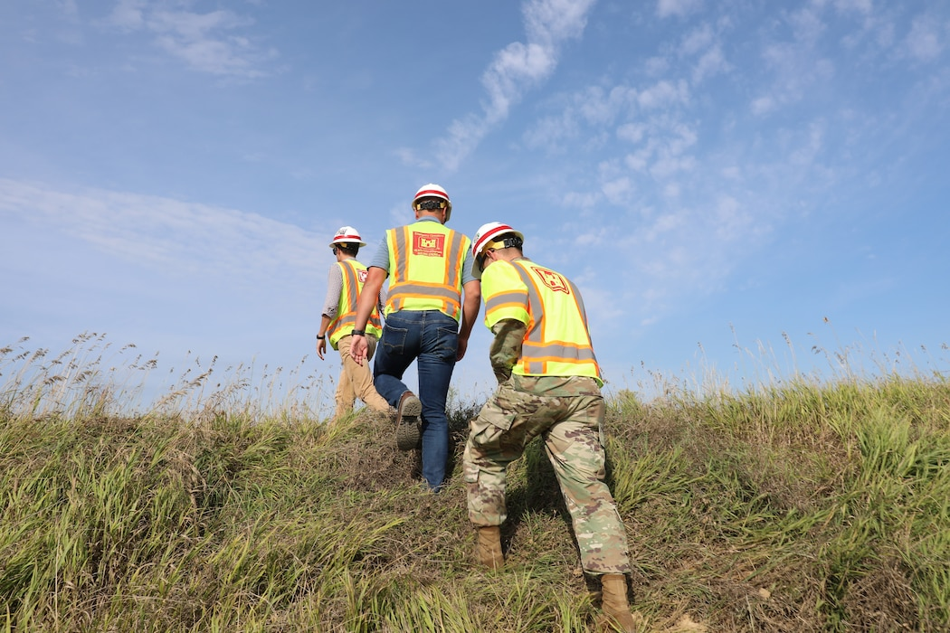 Col. John Hudson and USACE Omaha District employees review progress on Levee L611-614 near Council Bluffs, Iowa Aug. 23, 2019.