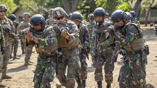 U.S. Marines with Alpha Company, 1st Battalion, 3rd Marine Regiment conduct MOUT training with Indonesian Marines during the Korps Marinir (KORMAR) Platoon Exchange 2019 program in Surabaya, Indonesia, August 9, 2019. The KORMAR platoon exchange program between Indonesia and the U.S. involves each country sending a platoon of Marines to live and train together at the other's military base. This program enhances the capability of both services and displays their continued commitment to share information and increase the ability to respond to crisis together. (U.S. Marine corps photo by Cpl. Eric Tso)