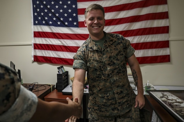 U.S. Marine Corps Sgt. Scott Roguska, the combat graphics specialist for Marine Corps Base Hawaii (MCBH) Communication Strategy and Operations, shakes hands with a monitor during the annual Manpower Management Enlisted Assignments (MMEA) Roadshow, MCBH, Aug. 20, 2019. Marines from various units aboard the base got a chance to meet face-to-face with their monitor and receive career counseling, orders, and receive on the spot approval for reenlistment. (U.S. Marine Corps photo by Pfc. Samantha Sanchez)
