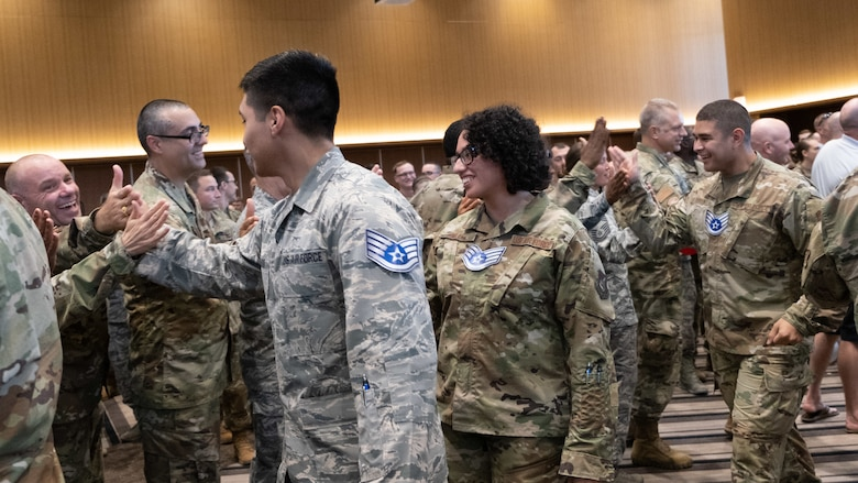 The Kadena Shoguns celebrate their newest staff sergeant selects during a celebration at Kadena Air Base, Japan, Aug. 23, 2019. Across the 18th Wing, 380 senior airmen were selected for promotion to staff sergeant. (U.S. Air Force photo by Staff Sgt. Benjamin Raughton)