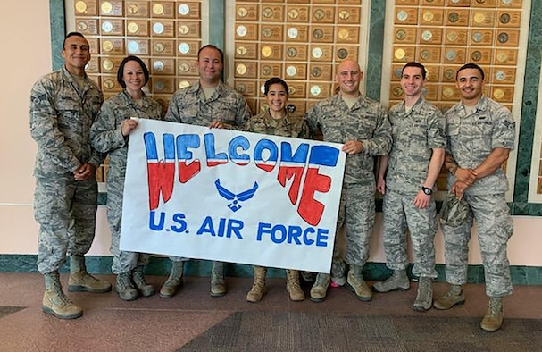 (left to right) Senior Airman Carter, Master Sgt. Kelly, Tech. Sgt. Nicoletti, Senior Airman Faur, Senior Airman Greene, Tech. Sgt. Schnetz and Senior Airman Mitchell, Reserve Citizen Airmen from the 655th Intelligence, Surveillance and Reconnaissance Wing, 50th Intelligence Squadron, hold a sign created by patients of Shriners Children's Hospital.