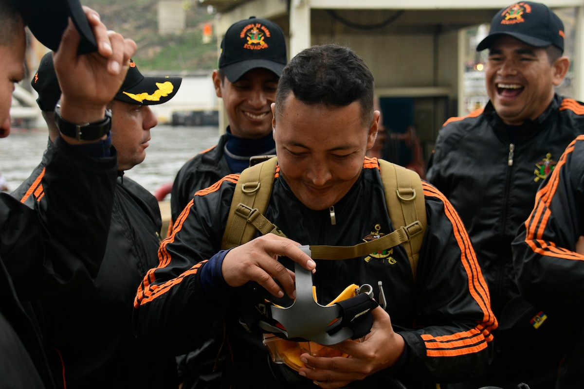 An Ecuadorian Navy diver examines an MK-20 dive mask.