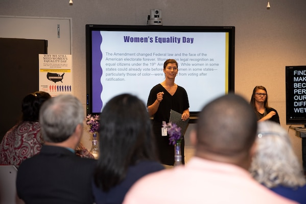 Defense Logistics Agency associate and guest speaker Natalie Thurston provides some historical reference to the journey and challenges that women have triumphed over to secure the right to vote.