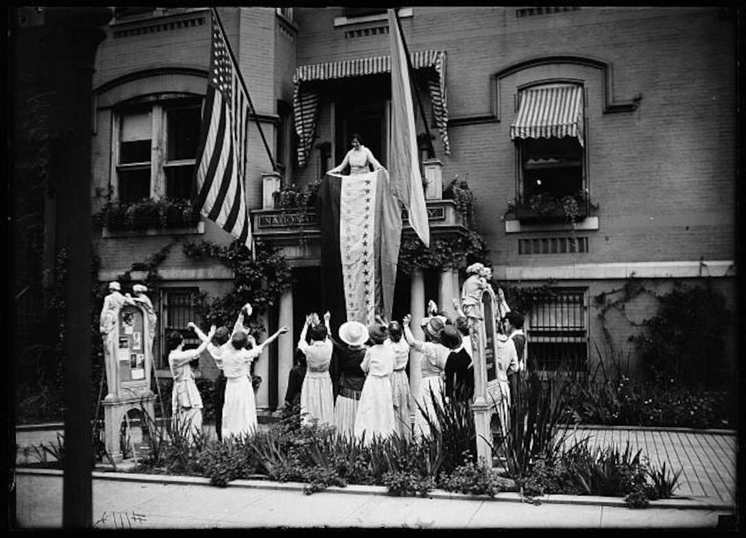 Alice Paul, National Woman's Party chair, unfurled the ratification banner at the NWP headquarters in Washington, D.C., following the Nineteenth Amendment's ratification.