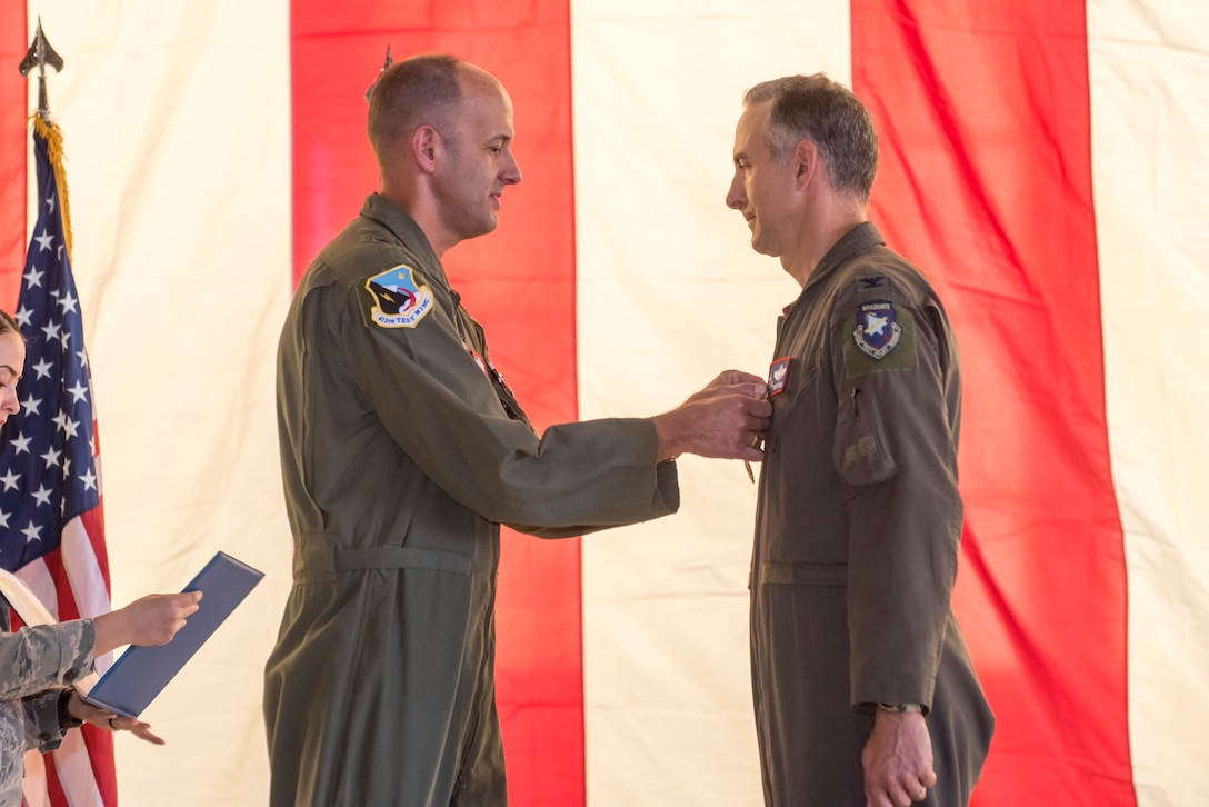 "Col. Christopher J. Spinelli receives Legion of Merit award from Brig. Gen. E. John ""Teichert"" during change of command ceremony"