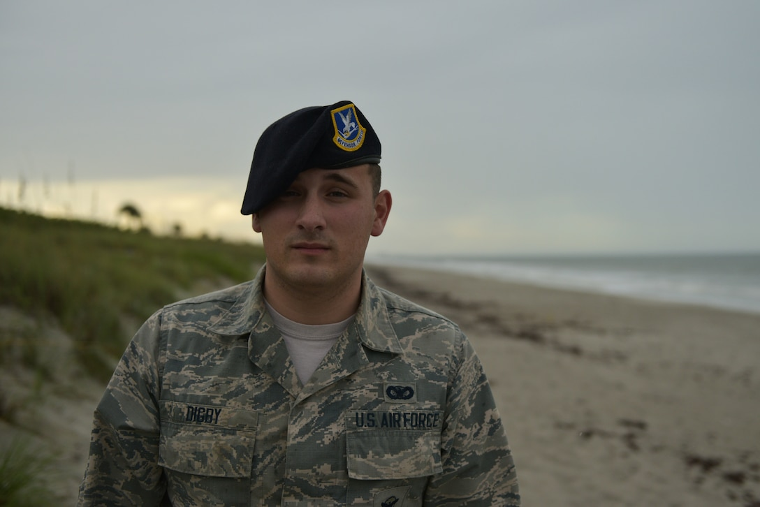 Airman 1st Class Tyler Digby, 45th Security Forces Squadron, installation entry controller, poses for a photo on the beaches at Patrick AFB, Fla., August 7, 2019. Digby was recently awarded the Medal of Valor at the Melbourne Regional Chamber Valor Awards. (U.S. Air Force photo by Airman 1st Class Dalton Williams)