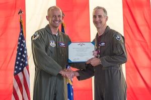 "Col. Christopher J. Spinelli receives Legion of Merit award from Brig. Gen. E. John ""Dragon"" Teichert during change of command ceremony"