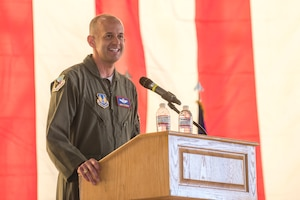 """Brig. Gen. E. John """"Dragon"""" Teichert delivers opening remarks at the change Of command ceremony for Col. Christopher J. Spinelli and Col. Timothy J. Spaulding."""