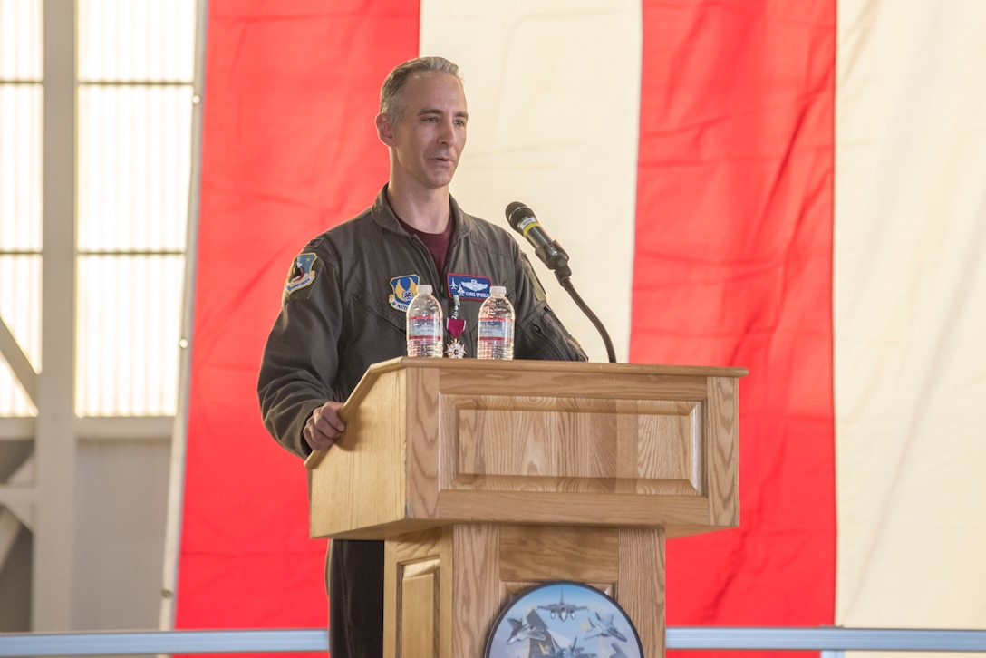 Col. Christopher J. Spinelli addresses the crowd at the change of command ceremony.