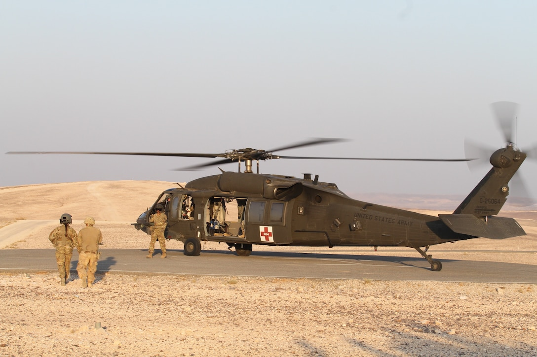 Members of the Medical Evacuation Platoon with the U.S. Army Reserve's 5th Battalion, 159th Aviation Regiment, Task Force Javelin prepare to load a simulated casualty as part of medevac training Aug. 24, 2019, in Jordan during preparations for Exercise Eager Lion 19. This multinational exercise is U.S. Central Command's premiere exercise in the Levant region and is a major training event that provides U.S. forces, Jordan Armed Forces and 28 other participating nations the opportunity to improve their collective ability to plan and operate in a coalition-type environment. (U.S. Army Reserve photo by Sgt. Zach Mott)