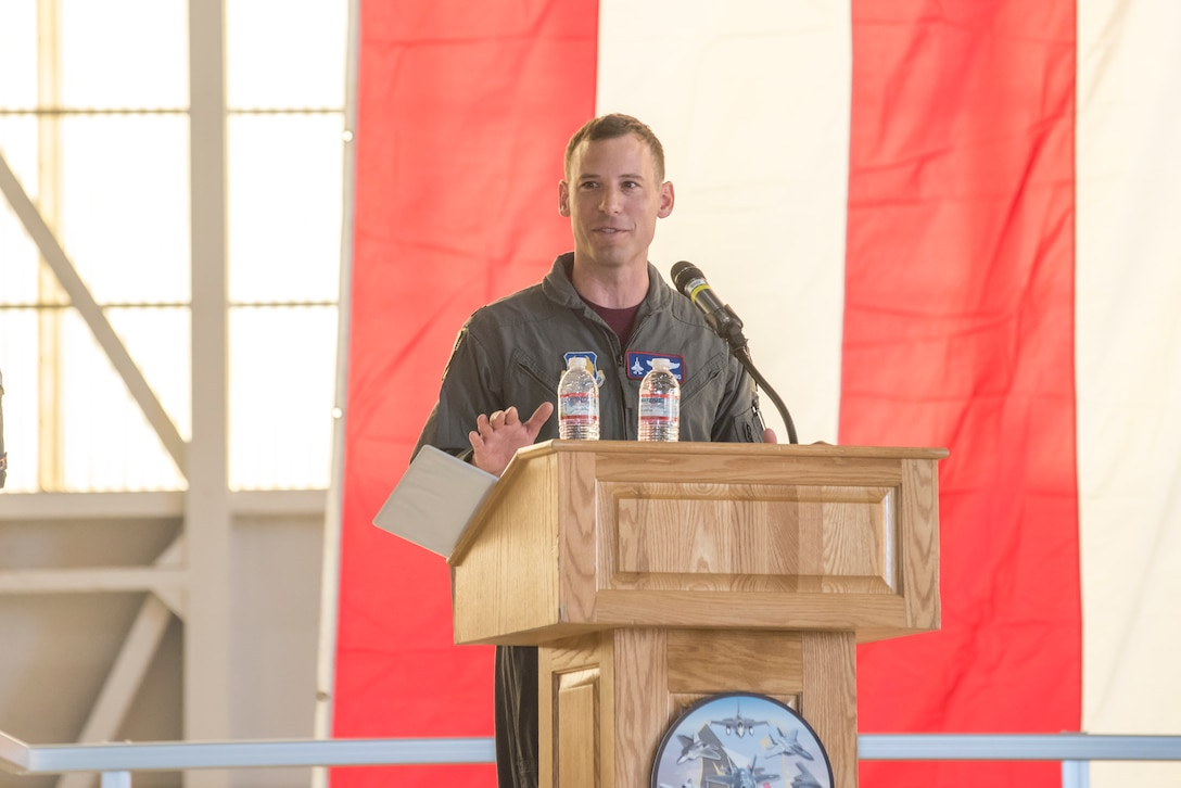 Col. Timothy J. Spaulding gives speech as he assumes the command of 412th Operations Group on 23 AUG 2019