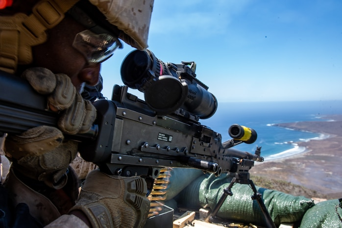 U.S. Marine Corps Lance Cpl. Dontaye Payton, an ammunition technician assigned to 1st Air Naval Gunfire Liaison Company, I Marine Expeditionary Force Information Group, fires an M240B machine gun during a live-fire range as a part of a field exercise on San Clemente Island, California, July 26, 2019. 1st ANGLICO participated in a field exercise to train to serve as a forward observer and liaison to orchestrate fire support during interagency, interservice and coalition operations.